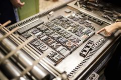 Old typography printing machine. With font characters for craftman typography stock photography