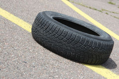 Old tyre. The old car tire lays on road Royalty Free Stock Image
