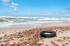 Old Tyre. Beside the sea Stock Photo