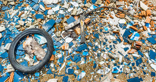 An old tyre in a broken glass zone Royalty Free Stock Image