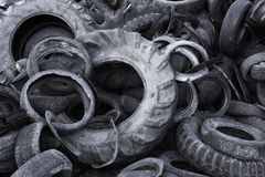 Old tyres. Heap of old torn used automobile tyres Royalty Free Stock Image