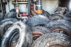Old tyres in an industrial warehouse Royalty Free Stock Photos