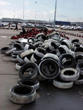 Old tyres and parking lot. Old tyres prepared to make a tyre heap for races. parking lot in the background Stock Photography