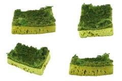 Old uesed dishware sponges on white background Royalty Free Stock Image