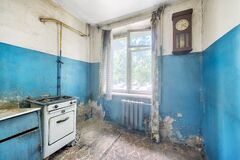 Old ugly abandoned empty kitchen in a residential building