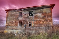 Old ugly dilapidated wooden house