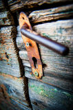 The old ugly rusty latch on wooden door Royalty Free Stock Image