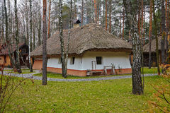 Old Ukrainian House. With a thatched roof in the forest Stock Photos