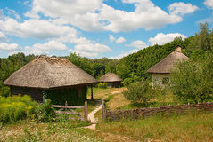 Old Ukrainian village, Pyrohiv, Ukraine. Old Ukrainian huts with thatched roofs, National Museum of Folk Architecture and Life of Ukraine Stock Photography