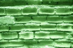 Old ultra green brick wall, stone background or rock surface - good for web site or mobile devices.  Stock Photo
