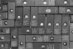 Old ultraviolet ROM chips background Stock Images