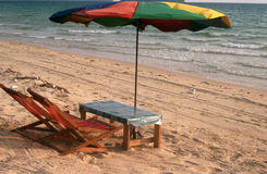 Old umbrella. 2 beach chairs and an umbrella stock photo