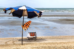 Old umbrella and chair beach Royalty Free Stock Image