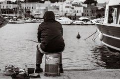 Old unemployed man fishing stock images