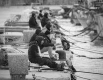 Old unemployed man fishing, Sicily, January 2019. Italy royalty free stock images