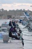 Old unemployed man fishing, Sicily, January 2019. Italy royalty free stock photography