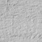 Old Uneven Brick Wall With White Painted Plaster Background Royalty Free Stock Photography