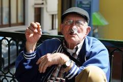 Old unidentified man smoking cigar Royalty Free Stock Image