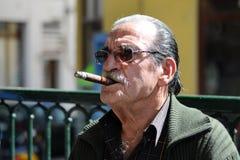 Old unidentified man smoking cigar Stock Images