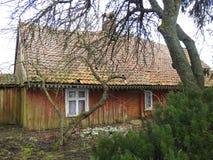 Old wooden home in village, Lithuania. Old uninhabitable home in village Minge in spring stock images