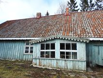 Old wooden home in village, Lithuania. Old uninhabitable home in village Minge in spring royalty free stock image