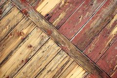 Old unique faded red barn wall background. Unique sideways diagonal barn wood weathered background with copy space Royalty Free Stock Images