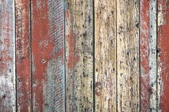 Old unique faded red wall background. Old unique natural red rust barn wood weathered background with copy space Stock Photos