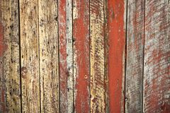Old unique faded red wall background. Unique rust barn wood weathered background with copy space Royalty Free Stock Photos