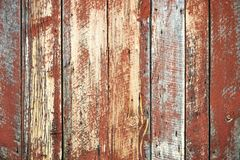 Old unique faded red wall background. Unique rust barn wood weathered background with copy space Royalty Free Stock Photography