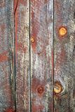 Old unique faded red wall background. Old unique natural verticaln rust barn wood weathered background with copy space Stock Photo