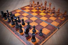 Old, unique and vintage chess set. Created with cardboard and pieces of wood Stock Photo
