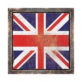 Old United Kingdom flag. 3d rendering of an United Kingdom flag over a rusty metallic plate wit a rusty frame. Isolated on white background Royalty Free Stock Image