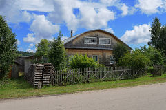 Old unpainted wooden house in village Royalty Free Stock Photos