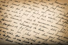 Old unreadable handwritten text aged paper texture background. Old unreadable handwritten text. Used aged paper texture background stock image