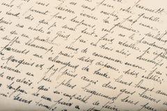 Old unreadable handwritten text paper texture background. Old unreadable handwritten text. Used paper texture background royalty free stock images