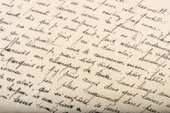Old unreadable handwritten text paper texture background. Old unreadable handwritten text. Used paper texture background royalty free stock photo