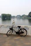 The old unused bike lay on the railing of houhai lake park, Beijing.  stock photo