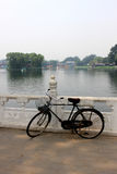 The old unused bike lay on the railing of houhai lake park, Beijing.  royalty free stock photos