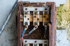 Old unused electric power distribution box. Close up shot on abandoned building royalty free stock images