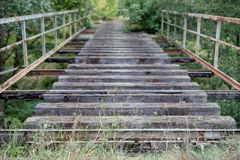 Old unused railway bridge. A small railway crossing over the riv stock photography