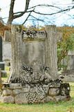 Old unusual tombstone tree trunks symbols Royalty Free Stock Photos
