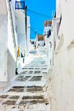 Old uphill street in Mykonos Stock Photo