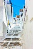Old uphill street in Mykonos Stock Photo