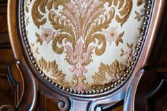 Old upholstered wood chair. Particular of an old upholstered wood chair to restore Royalty Free Stock Photography