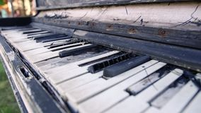 Old upright piano. Overview of a keyboard of an old piano Detail of the keyboard of one of the first pianos built. Antique music instrument of 1800s. History stock video footage