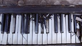 Old upright piano. Overview of a keyboard of an old piano Detail of the keyboard of one of the first pianos built. Antique music instrument of 1800s. History stock video