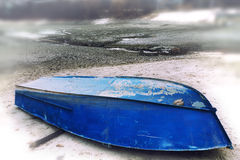 Old Upturned Boat Blue Lies on the Shore of the Dried Lake . Royalty Free Stock Photography