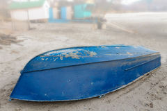 Old Upturned Boat Blue Lies on the Shore of the Dried Lake . Royalty Free Stock Images