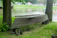Old upturned rowboat on the shore. Stock Images