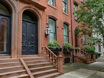 Old urban brownstone type townhouse with double door. Stone front step of elegant old urban brownstone type townhouse with double door stock images